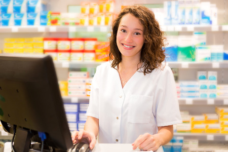 medecine: View of an attractive pharmacist at work