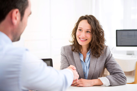 work office: View of a Young attractive woman during job interview