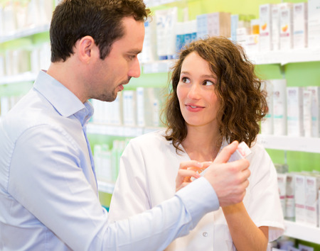 advising: VIew of an Attractive pharmacist advising a patient