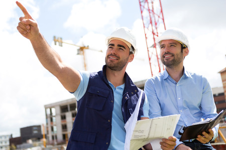 View of a Worker and architect watching some details on a construction Standard-Bild