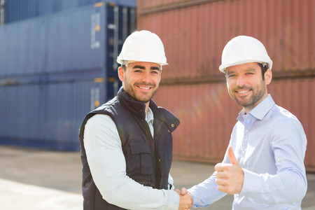 View of a Docker and supervisor handshaking in front of containers