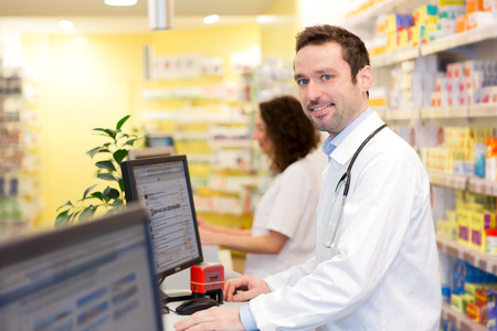 pharmacist: View of an attractive pharmacist team at work Stock Photo
