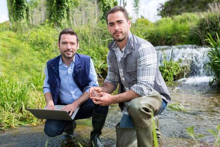 biologist: View of a Scientist and biologist working together on water analysis