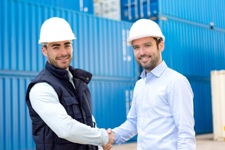 docker: View of a Docker and supervisor handshaking in front of containers