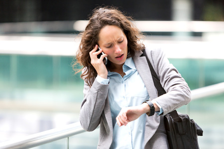 rendezvous: View of a Young attractive woman being late to a rendez-vous Stock Photo