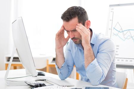 burn out: View of a Young attractive business got headache because of burn out