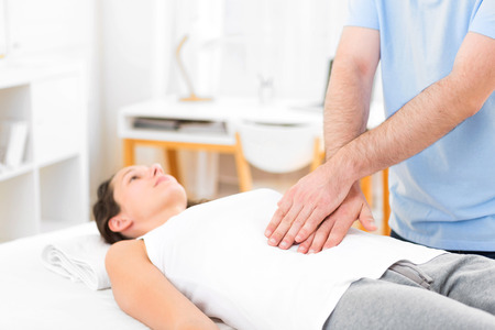 manipulated: View of an Young attractive woman being manipulated by physiotherapist Stock Photo