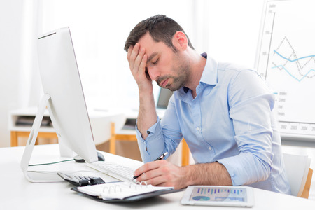 View of a Young attractive business feeling pain because of burn out