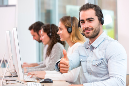 support group: View of a Young attractive man working in a call center Stock Photo