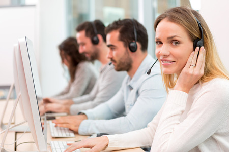 on call: View of a Young attractive woman working in a call center Stock Photo