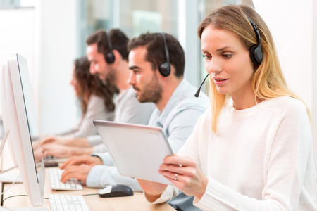co workers: View of a Young attractive woman working in a call center Stock Photo