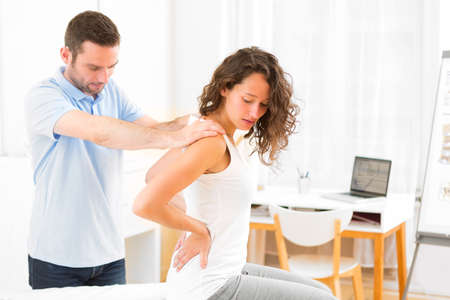 medecine: View of an Young attractive woman being manipulated by physiotherapist Stock Photo