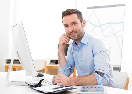 thirties: View of a Young attractive businessman at the office Stock Photo