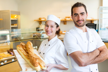 baker: View of a Team of bakers working at the bakery
