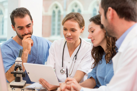 View of a Medical team working at the hospital all together Stock Photo