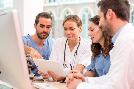 medecine: View of a Medical team working at the hospital all together Stock Photo