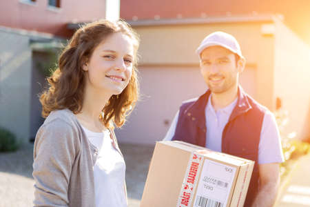 cardbox: View of a Young attractive woman receiving parcel at home