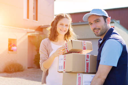 house exchange: View of a Young attractive woman receiving parcel at home
