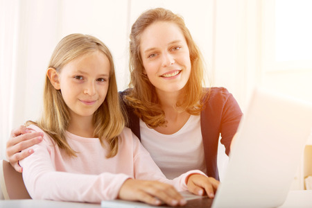 pedagogy: View of a Woman helping out her little sister for homework