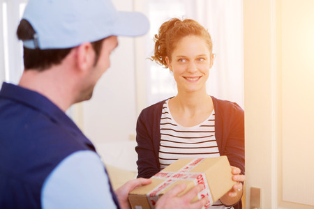 cardbox: View of a Delivery man handing over a parcel to customer