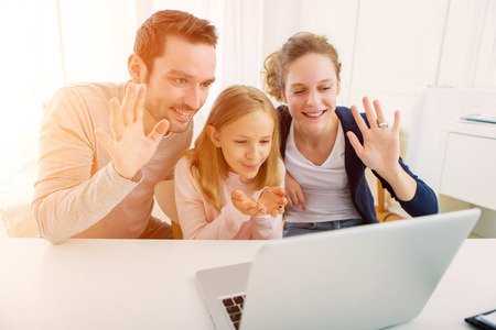 View of a Family having a videocall on a laptop Standard-Bild
