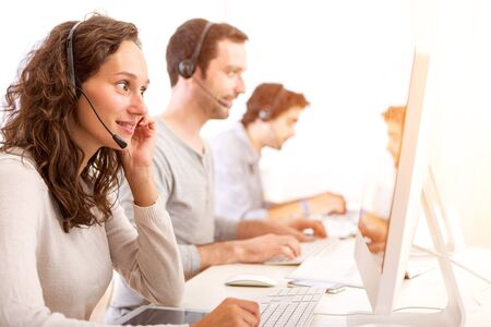View of a Young attractive woman working in a call center Stock Photo