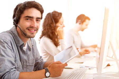 View of a Young attractive man working in a call center Stock Photo
