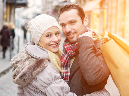 couple winter: View of a Young attractive couple with shopping bags Stock Photo