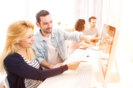 happy business team: View of a Young attractive people working together at the office