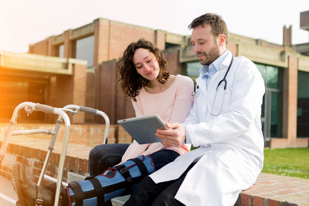 medecine: View of a Doctor showing reeducations tips on tablet