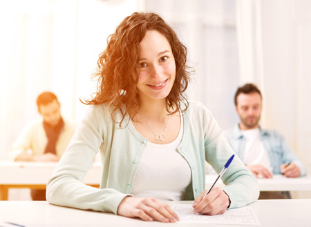 school exam: View of a Young attractive student taking exams Stock Photo