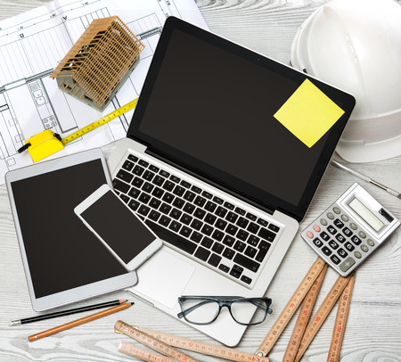 glasses model: View of a Wood architects desk in high definition with laptop, tablet and mobile Stock Photo