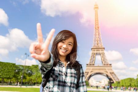 View of a Young attractive asian tourist visiting Paris Banco de Imagens