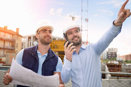 View of a Worker and architect watching some details on a construction Stock Photo