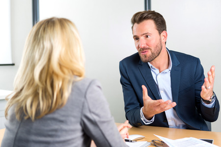 employer: View of a Young attractive employer doing a job interview to a woman