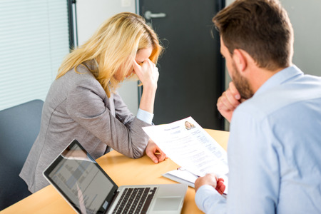 embarassed: View of a Young attractive woman upset during job interview Stock Photo