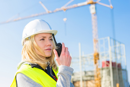 View of an attractive woman worker on a construction site Stock fotó