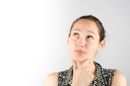 cogitate: View of a beautiful woman cogitate isolated on a white background