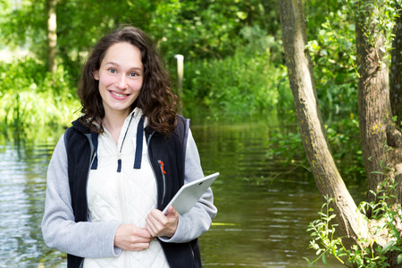 View of a Young attractive biologist woman working on water analysis