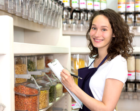 basura organica: View of a Young attractive woman working at the grocery store