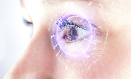 futuristic eye: View of the Eye of a woman with digital interface in front of it
