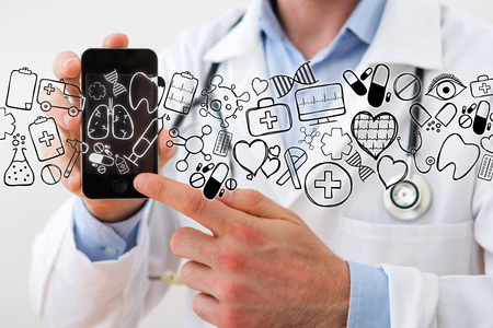 View of a Professional Doctor handing a smartphone with icons around Stock Photo