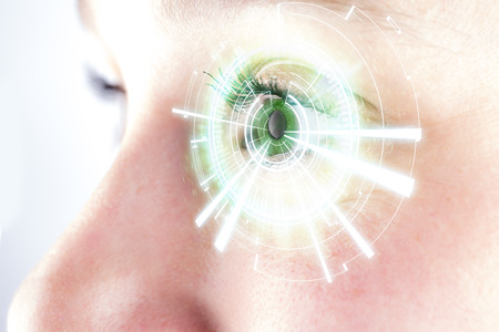 digital eye: View of the Eye of a woman with digital interface in front of it