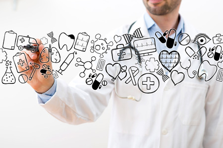 View of a Professional Doctor drawing icons with a pen - medical concept Stock Photo