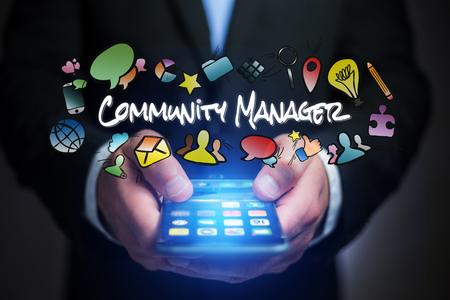 Concept view of man holding smartphone with community manager title and multimedia icons flying around