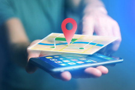 localization: Vuiew of a Concept of geographical localization on a map with a smartphone