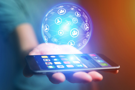 View of a Businessman holding smartphone with network globe sphere hologram going out - Technology concept