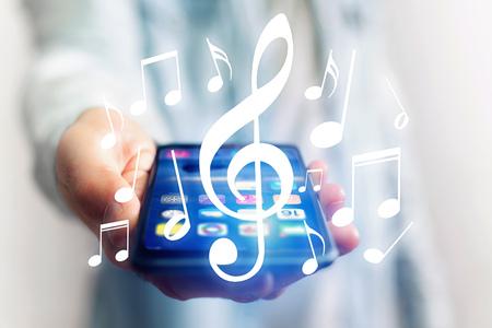 vue Concept de listenning musique sur un appareil - le concept de la technologie