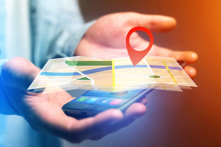 localization: Concept view of finding a place on an online map - Technology concept Stock Photo