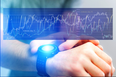 View of a Stock exchange trading data information going out the smartwatch of a businessman - Financial concept Stock Photo
